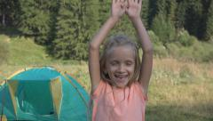 Happy Child Playing Looking Camera, Smiley Little Girl Making Sport, Camping Stock Footage
