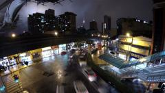 Rainy night traffic in Chow Kit intersection. 4K Stock Footage