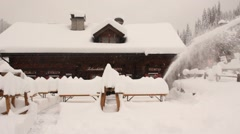 Snowblower use in snowy alps - stock footage