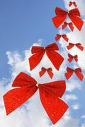 Red bow ribbons in the sky Stock Illustration