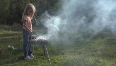 Child Preparing BBQ, Barbecue at Camping in Mountains, Little Girl Making Grill - stock footage