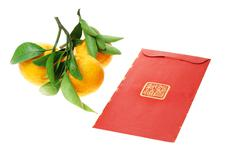 Chinese red packet and mandarin oranges Stock Photos