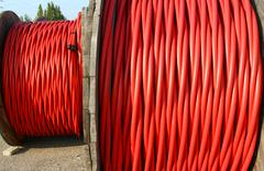 Coil of high voltage power cable the power the electric utilities Stock Photos