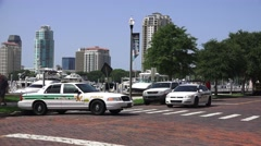 Police Cars And Officer On Brick Road Tampa Bay Marina And City Skyline 4K Stock Footage