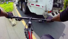 Cyclist trying to  skip a truck in city traffic - stock footage