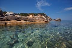 Rocks at Cala Sinzias beach and sea view, Sardinia Stock Photos