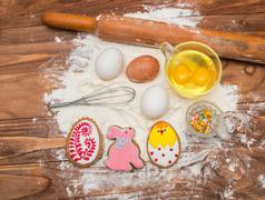 easter cookies and ingredients for cooking. - stock photo