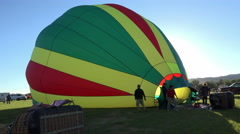 Hot Air Balloon filling with air on ground 4K 030 Stock Footage
