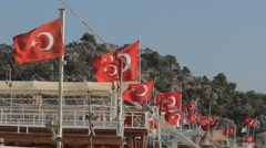 Turkish flags in a row on the masts of boats Stock Footage