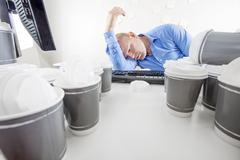 Exhausted and bored office worker Stock Photos