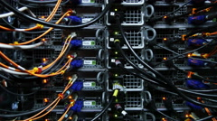Back side of  working data servers with flashing LED lights 4k Stock Footage