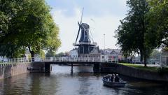 Windmill De Adriaan and bridge in Haarlem, Netherlands. Stock Footage