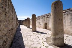 zapotec internal court with stone columns - stock photo