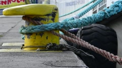 Bollard with rope and anchored ship Stock Footage