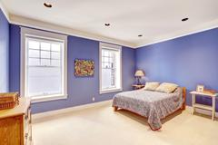 bright room with impressive purple color walls - stock photo