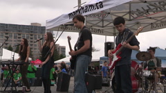 Children's festival and carnival with bouncy castles and concert. Stock Footage