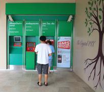 People make money transaction at atm Stock Photos