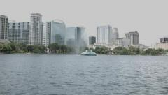 Cityscape and Fountain of Lake Eola on an Overcast Day - stock footage