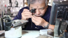 Stock Video Footage of watchmaker working with a small watch