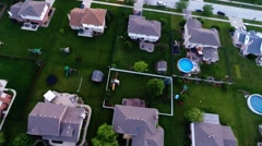 Aerial houses in residential suburban neighborhood backyard landscape - rooftops Stock Footage
