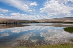 Lake steppe sky clouds Stock Photos