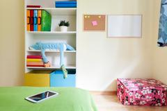 colorful kids room with white bookcase - stock photo