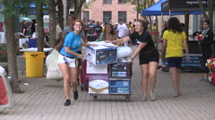 Stock Video Footage of College and university students moving in to campus residence in September