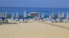 Deck Chairs On a Vacation Beach Stock Footage