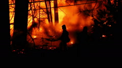 3 Fire Fighters battling wildfire - stock footage