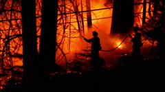 3 courageous fire fighters battle forest fire - stock footage