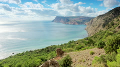 Cloudy sky over the mountains and the sea. Balaklava, Crimea, Russia. FULL HD - stock footage