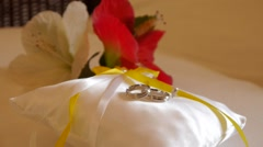 Gold wedding rings on the pincushion Stock Footage