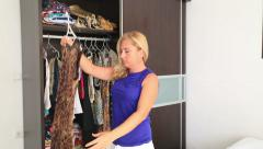 Women don't know what to wear - stock footage