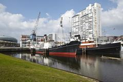 Bremerhaven (germany) - basin with historical ships and residential towers (r Stock Photos