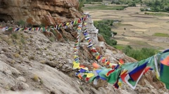 Plenty of colorful Buddhist prayer flags on the Stupa in Ladakh, India Stock Footage
