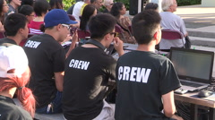 Community music festival and concert on summer day, Asian sound crew Stock Footage