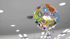 Stock Video Footage of congratulations balloon floating in the air
