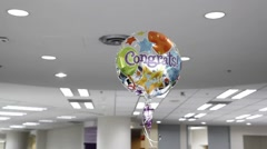 Congratulations balloon floating in the air Stock Footage