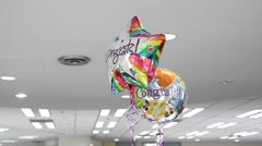 surprise congratulations balloon at workplace - stock footage