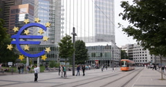 UHD 4K Modern Tram Passing German City Symbol Euro Sign Frankfurt People Walking Stock Footage