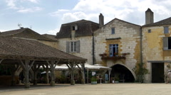 Covered market in Place des Cornieres, Monpazier France Stock Footage