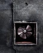 Abandoned air conditioning duct and rusted fan Stock Photos