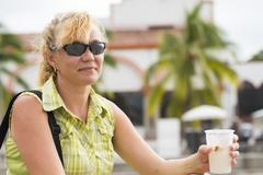 woman resting drinking fruit water in mexico - stock photo