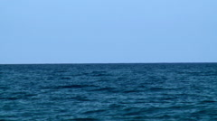 Clear blue sea and smooth blue sky. - stock footage