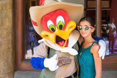 Girl posing with woody woodpecker Stock Photos