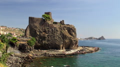 Norman Castle on the rocky waterfront at Aci Castello town. Stock Footage