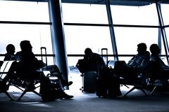 People traveling on airport silhouettes Stock Photos