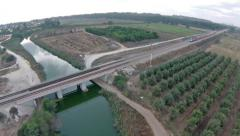 Train crossing the a bridge in the country. Israel Stock Footage