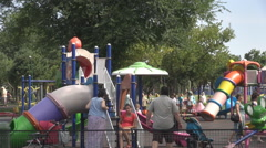 Lot of fun in playground children with parents play happy families entertainment Stock Footage