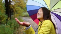 Autumn / fall woman happy in rain with umbrella - stock footage